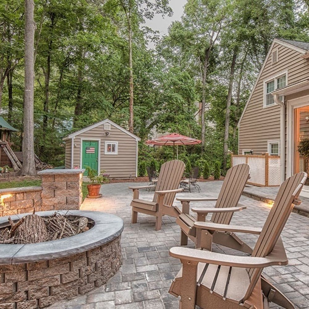 Outdoor living space with a fire pit, patio pavers, and patio furniture