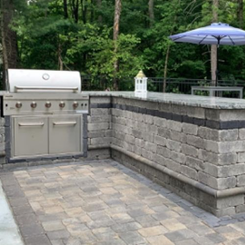 outdoor kitchen, grill, and patio pavers by jm mento landscape design