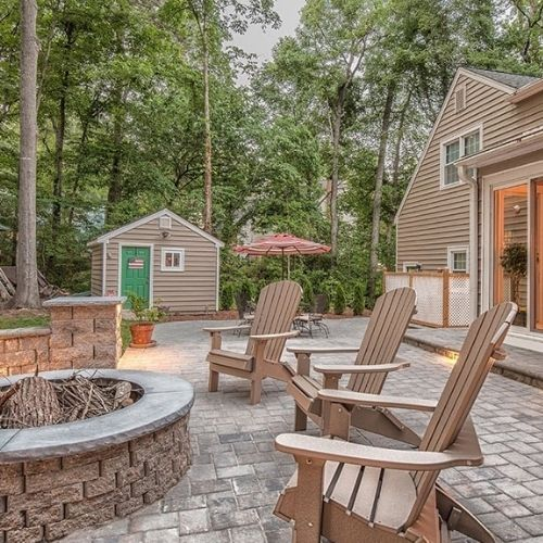 patio pavers and fire pit in a residential backyard in Massachusetts