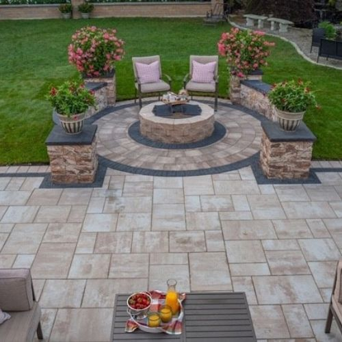fire pit and outdoor kitchen in backyard of residential home in Massachusetts