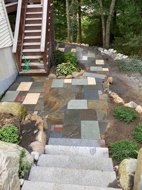 Different types of pavers installed in a residential walkway