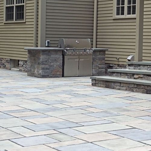 Patio pavers installed into residential landscape design in Massachusetts
