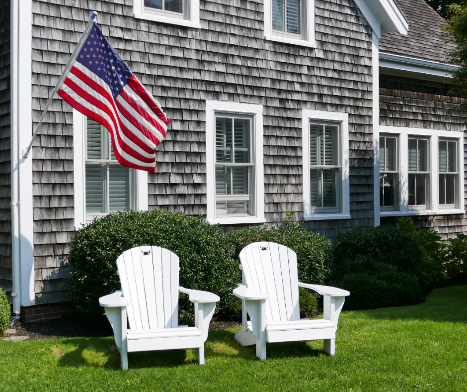 Cape Cod landscape design feature two Adirondack Chairs and American Flag