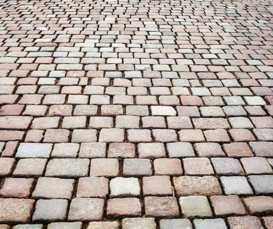 cobblestone paver installation with different color paving stones