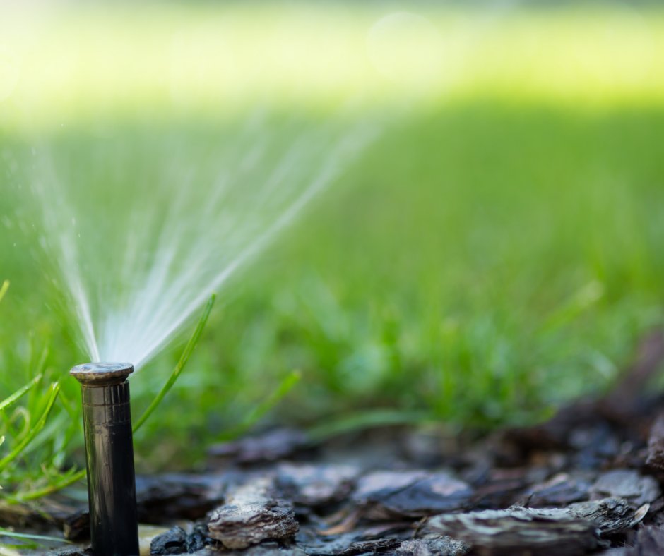 irrigation system in function on residential lawn