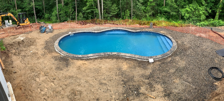 The JM Mento landscape design team build a swimming pool in Massachusetts