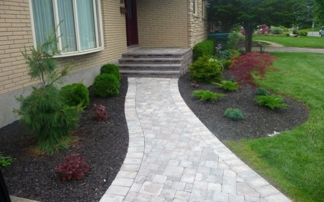 walkway paving stone installation in Massachusetts backyard